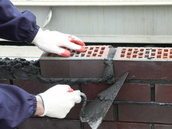 Кирпичная кладка на цементном растворе вибратор в бетон